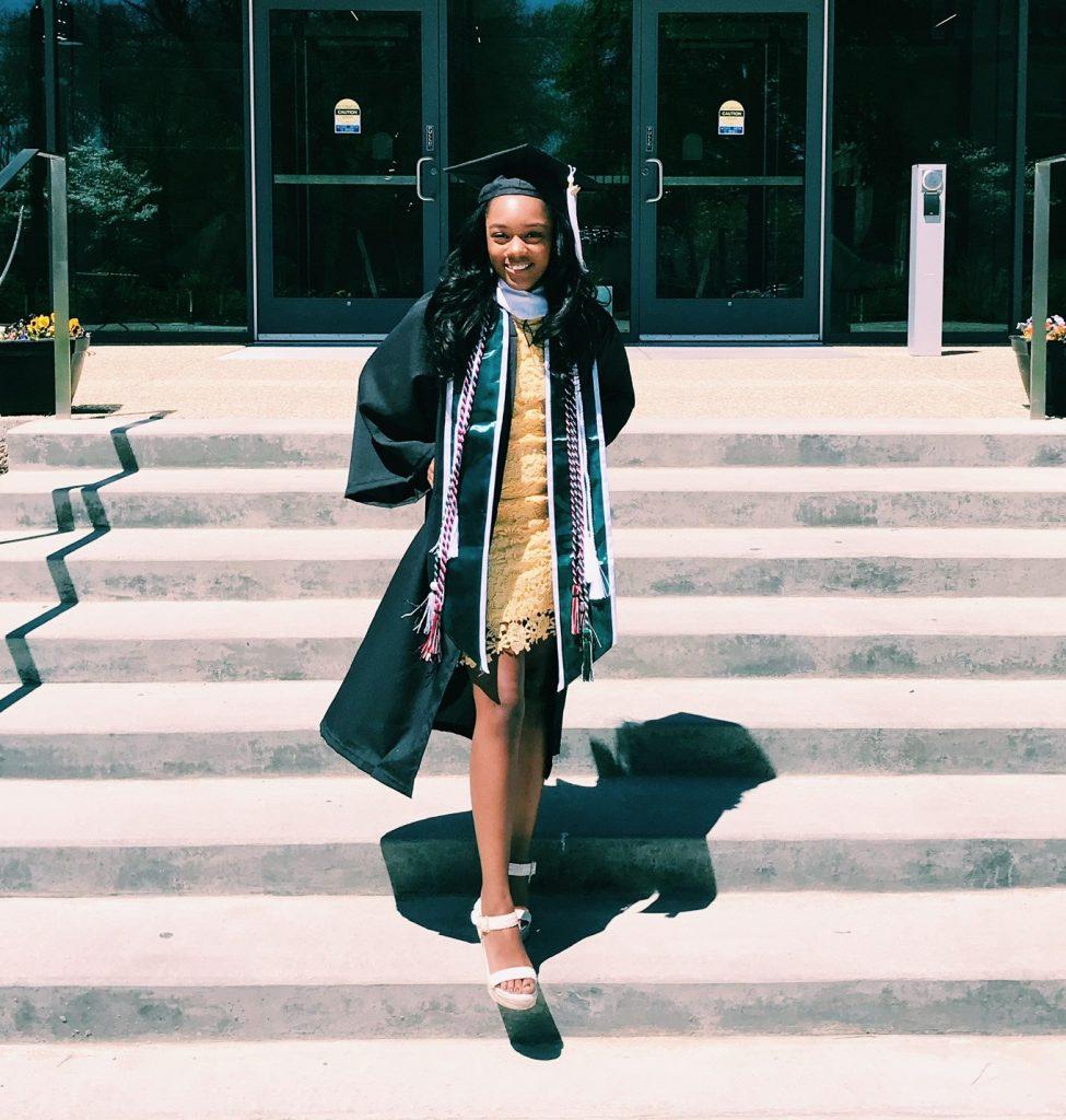 Woman smiling in graduation attire.