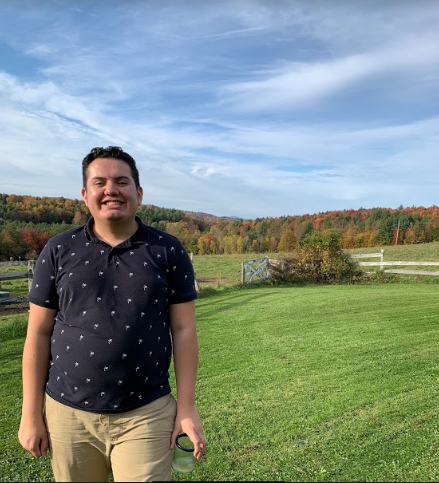 Smiling man outdoors.